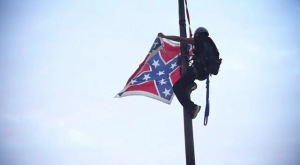 Bree Newsome scales the flagpole at the South Carolina Statehouse to remove the Confederate flag